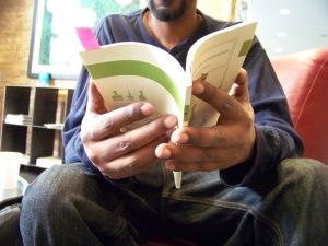 Dane Swans hands holding book