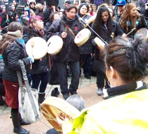 Native Women drumming at rally 2013