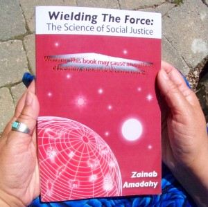 Zainabs hands holding book