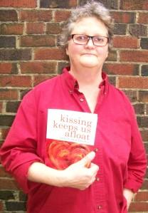 Laurie MacFayden holding her book